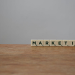Scrabble tiles spell out 'marketing'